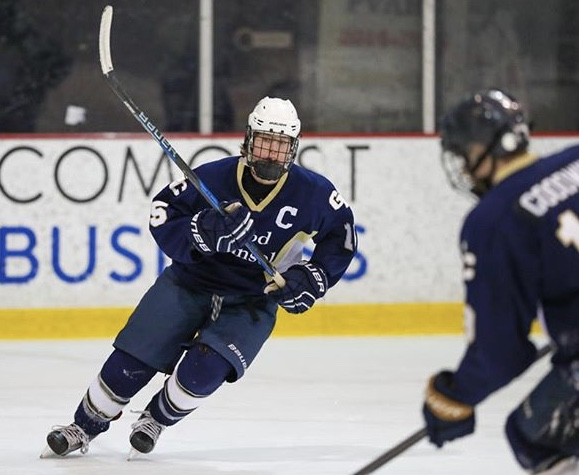 Falcon hockey player flying on the ice to receive a pass from his fellow Falcon.