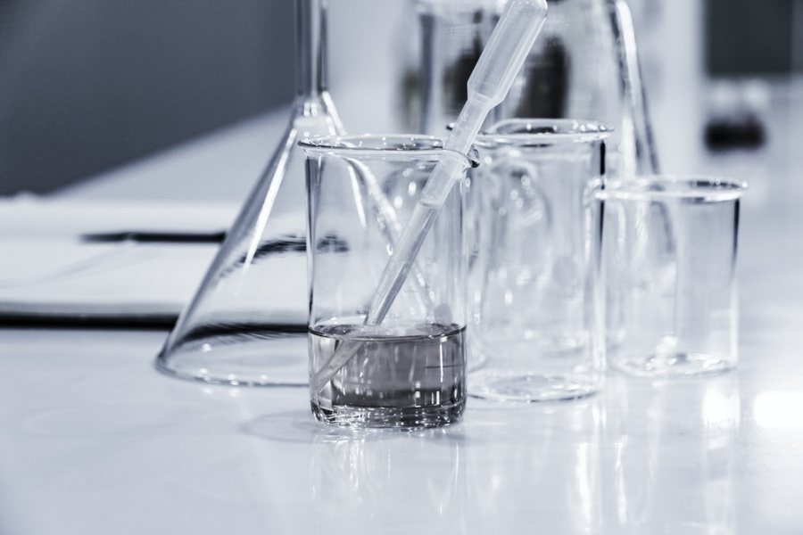 The tools of the science lab: three clear breakers placed on a lab tabletop.